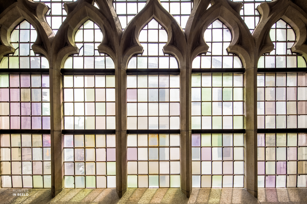 BREDA, NETHERLANDS - APRIL 29: View on market through glass stained window in the meeting room, Kapittelzaal, in the historical 15th centrury church, main monument, in Breda, the Netherlands, on April 29, 2015